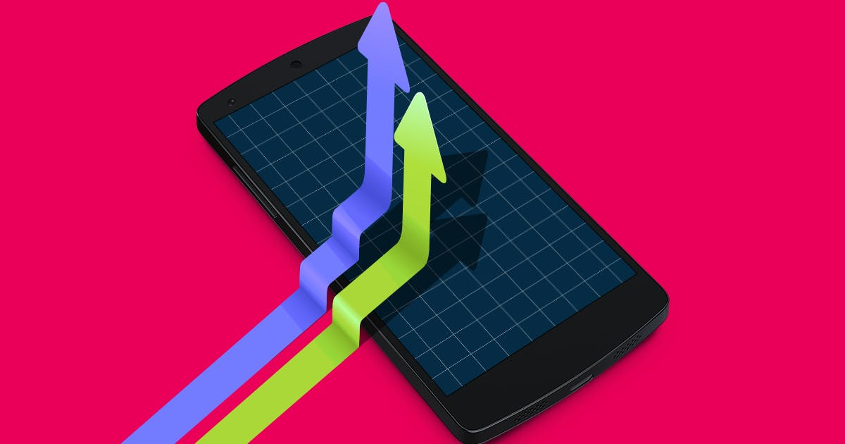 Positiv verlaufende Graphen vor einem Handy